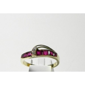 Bague volute or 14 kt diamants et pierres rouges
