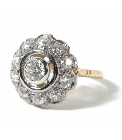 """Marguerite aux diamants"", bague or platine et diamants"